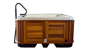 Hot tub with a handrail